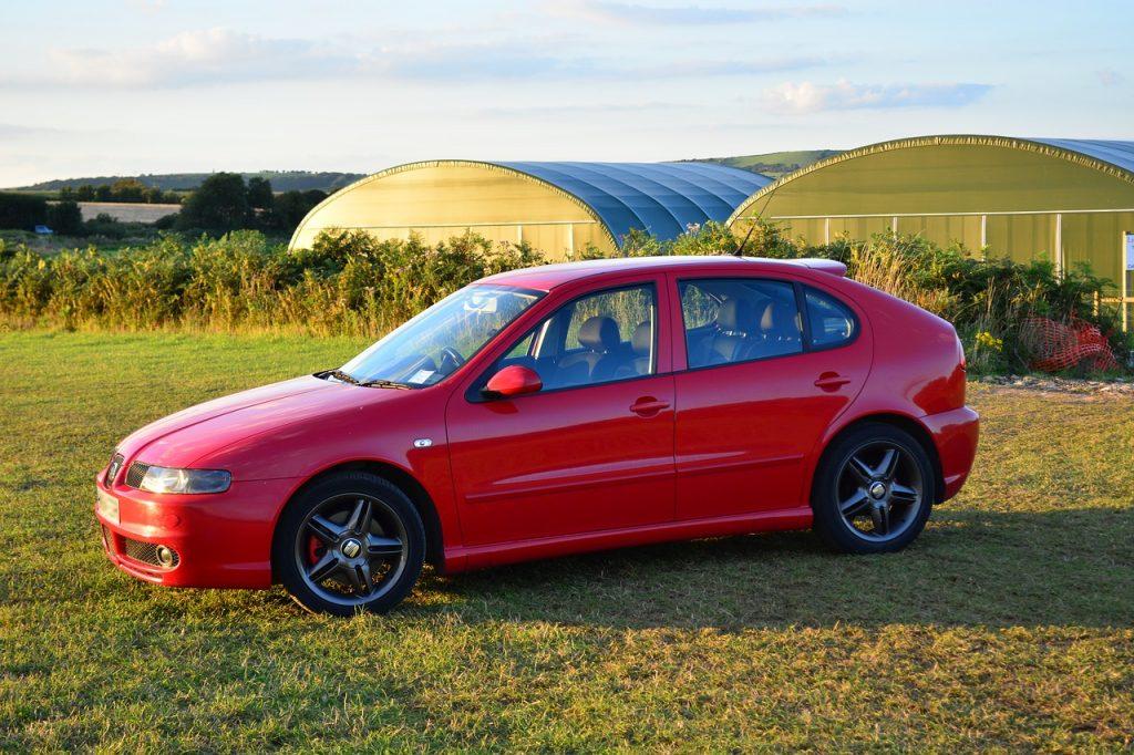 red-car-in-field