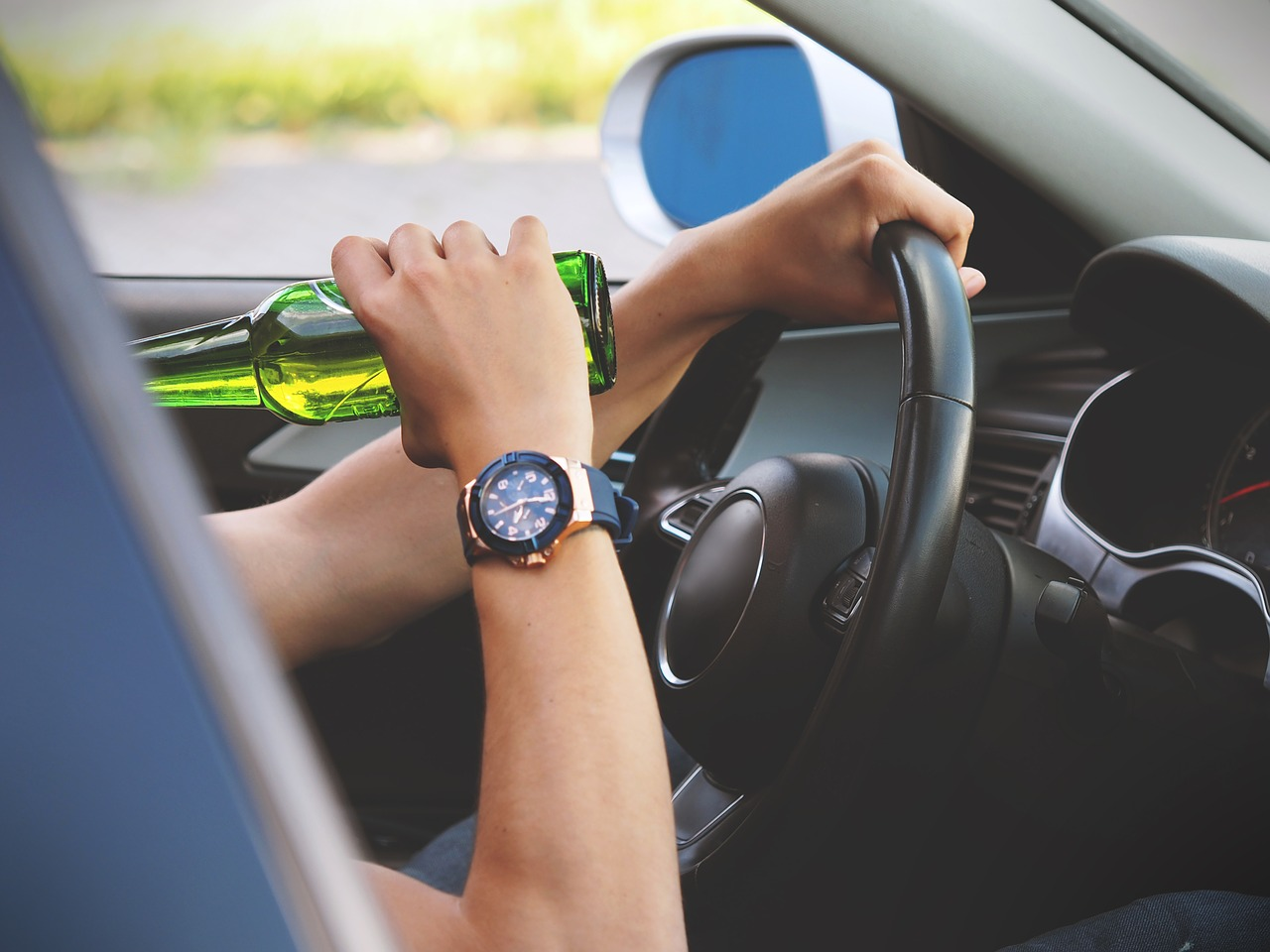 person drinking at the wheel