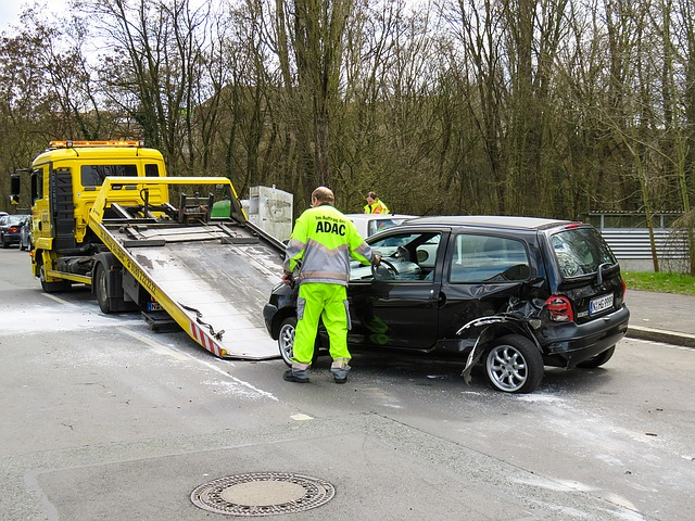 crashed vehicle being towed away