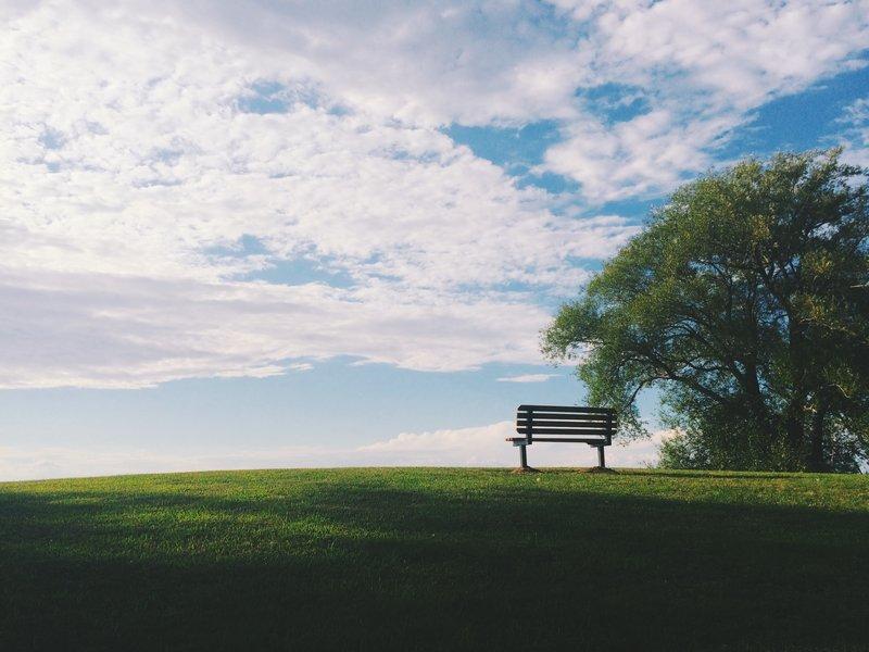 Bench facing a cloudy sky