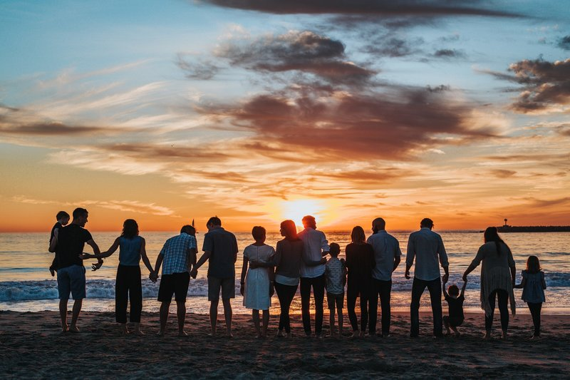 Extended family and friends on a beach