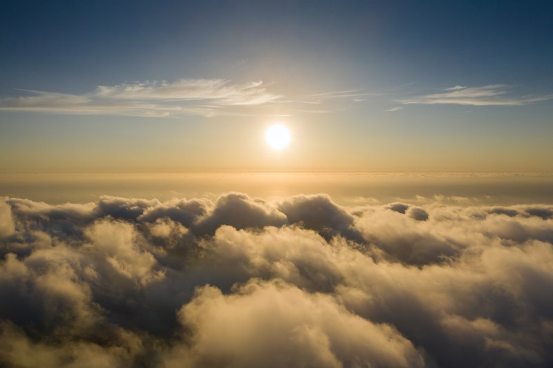 Sun shining in the sky above the clouds