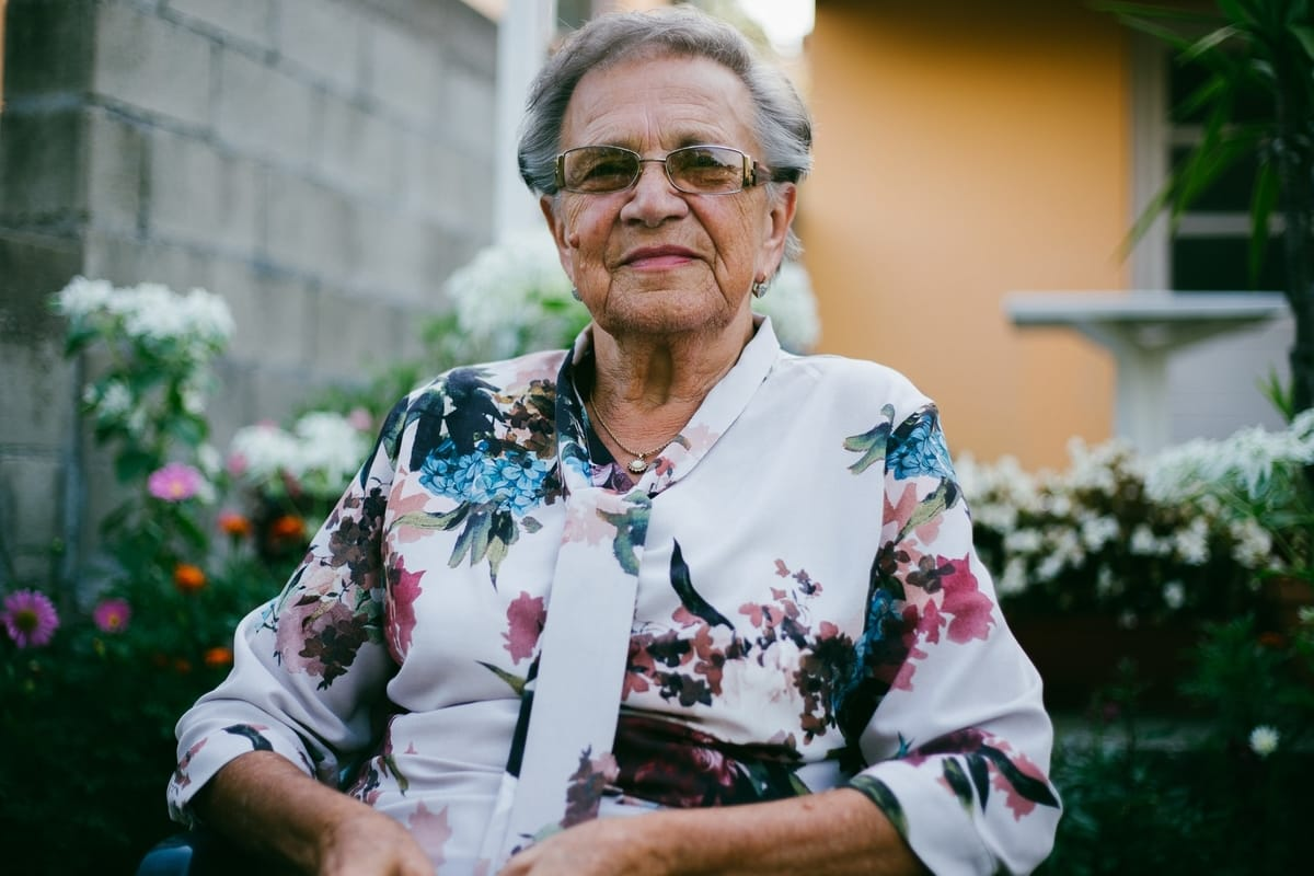 elderly lady smiling happily at camera