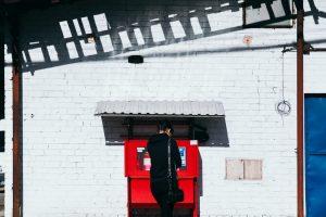 Man standing at an ATM