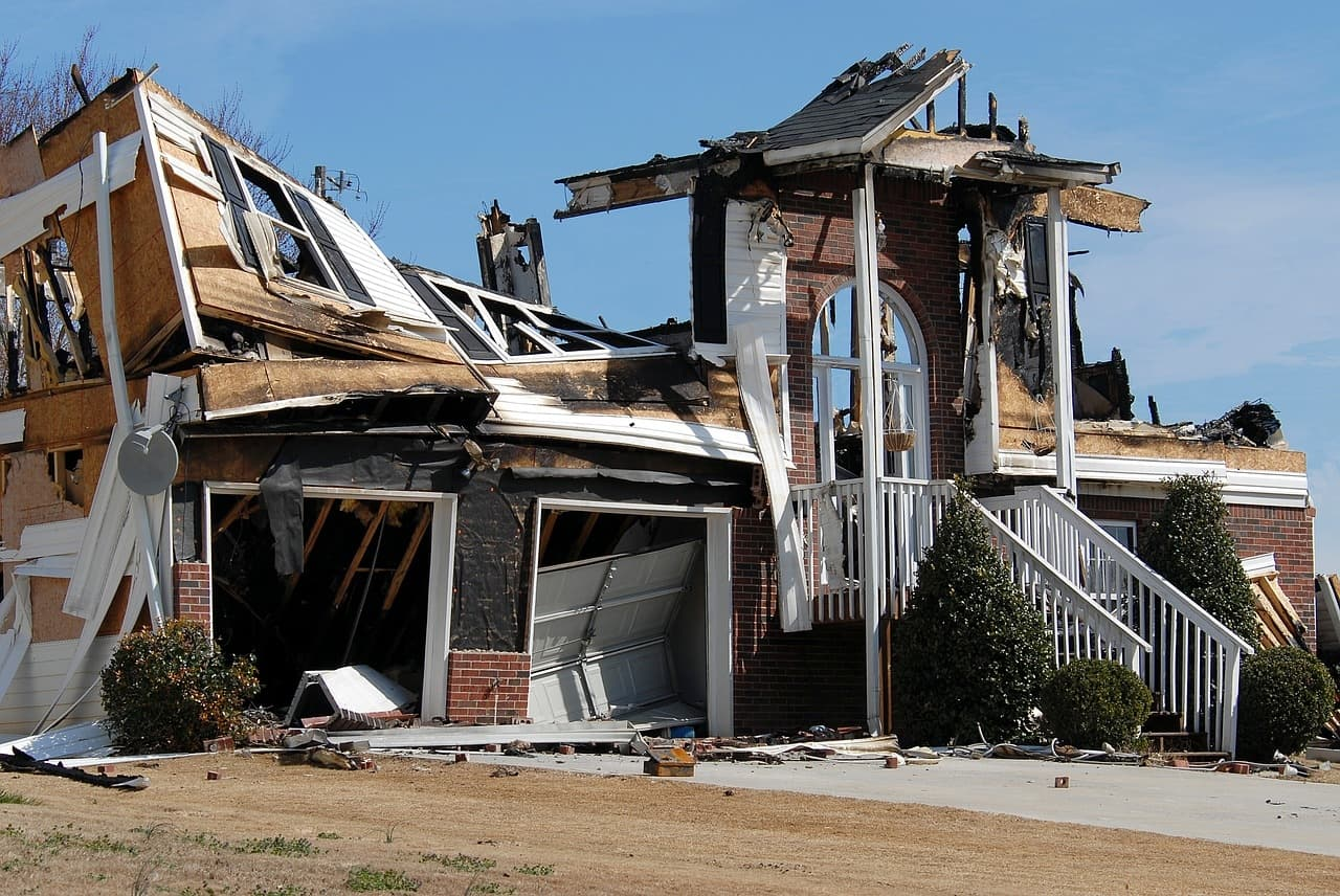 A burnt-down house destroyed by fire