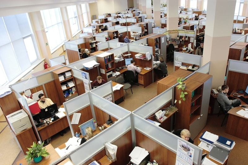 Aerial view of an office with cubicles where employees are hard at work