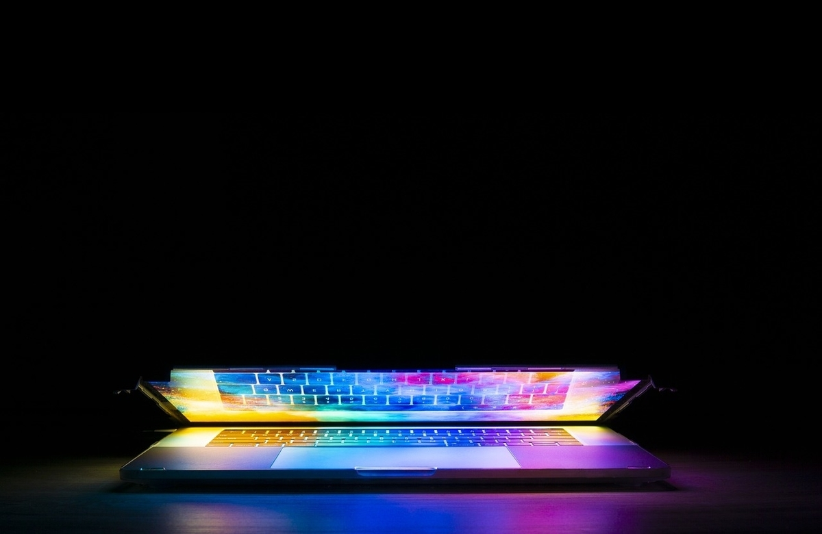 Colourful laptop screen glowing in the dark