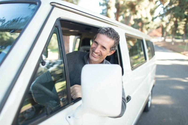 happy man in minivan automobile