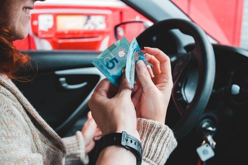 handing over money inside car