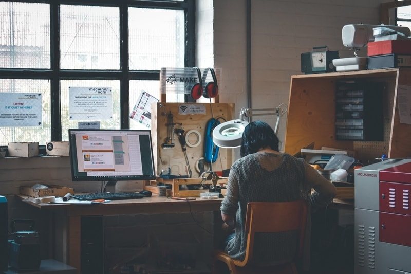 Back of women working at her desk against the window