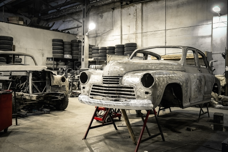 An old car in a restoration shop